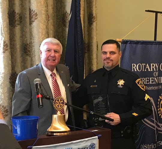 Master Deputy Frank Abella, right, pictured with Greenville County Interim Sheriff Johnny Mack Brown, was honored by the Greenville Rotary Club on Tuesday.
