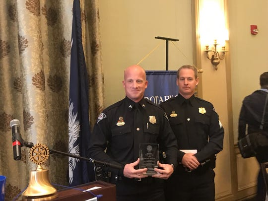 Greenville Police Officer Andrew Sturman, left, pictured with Sgt. Jason Semanyk, was honored by the Rotary Club of Greenville on Tuesday.