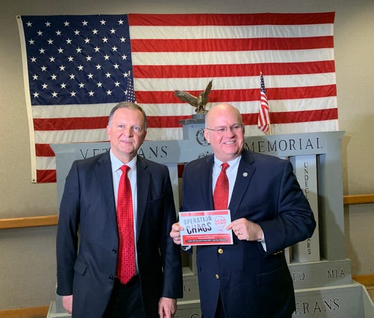 Stephen Brown (left), former chairman of the Greenville County Republican, and Pressley Stutts, chairman of the Greenville Tea Party, pose for a photo on Tuesday, Feb. 25, 2020 at Greenville County Square after holding a press conference urging Republican voters to support Bernie Sanders in the South Carolina Democratic Primary.