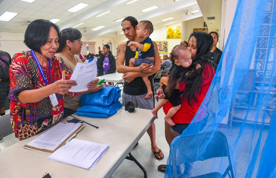 Couple, Mark Jackson and Amberlyn Cruz, were the first on hand to pick up free mosquito nets being offered to qualifying island households at the Astumbo Senior Citizens Center in Dededo on Tuesday, Feb. 25, 2020. The nets were part of 5,000 nets, donated by The CDC Foundation, intended to aid in Guam's battle against the spread of the dengue fever virus.