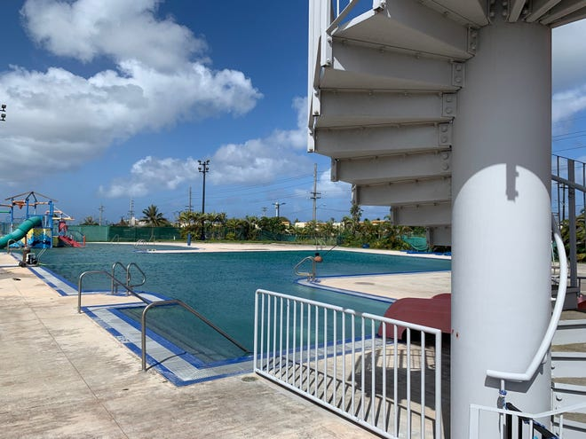 The closed Dededo public pool as photographed Feb. 24. According to Public Health inspectors, there are no documents to certify the water slide, at right, meets safety standards. The violation is one of nearly two dozen reported by inspectors, who closed the facility indefinitely.