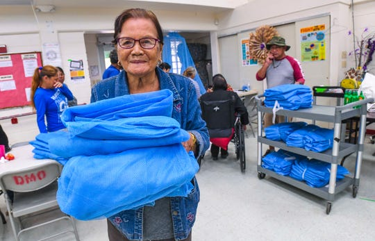 Machanao, Dededo resident Remedios Encio walks away with the free mosquito nets she received at the Astumbo Senior Citizens Center in Dededo on Tuesday, Feb. 25, 2020. The nets were part of 5,000 nets, donated by The CDC Foundation, intended to aid in Guam's battle against the spread of the dengue fever virus.