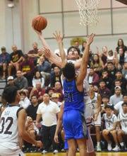 Father Duenas' Matthew Fegurgur shoots from the post during a game against the Saint Paul Warriors at the Father Duenas Memorial School Phoenix Center, Mangilao, Feb. 25, 2020.