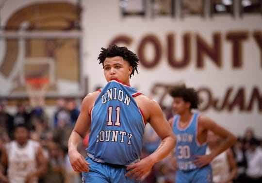 Union County's Keishon Martin (11) waits for the inbounds pass during their Sixth District Tournament game at Webster County High School Monday night, Feb. 24, 2020.