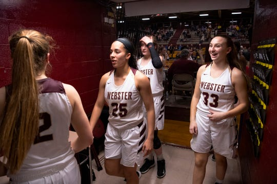 The Webster County Lady Trojans head for the locker room after defeating Union County during their Sixth District Tournament game at Webster County High School Monday night, Feb. 24, 2020.