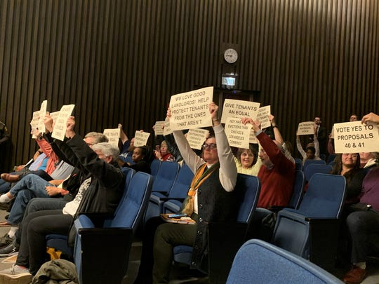 Supporters of a new tenant rights initiative urge councilors to vote in favor of the two proposals on Monday at the city-county building.