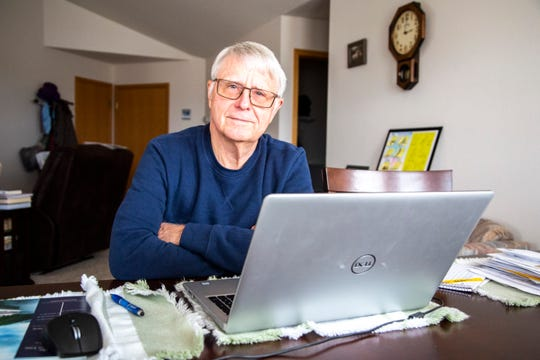 Wally Heitman, former mayor of University Heights, sits for a photo at his kitchen table, Tuesday, Feb. 25, 2020, in Iowa City, Iowa.