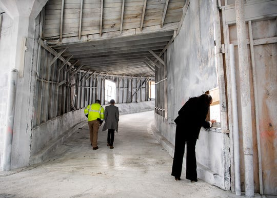 People walk through the building at 835 N. Central St in Knoxville that will transform into the new headquarters for Axle Logistics on Tuesday, February 25, 2020.