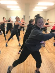 Mindy Bussart leads an exercise class at the Columbus Street location of Jackd Fitness.