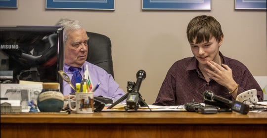Former Iroquois student Cameron Skaggs, right, speaks at a press conference with his lawyer, Teddy Gordon on Tuesday.