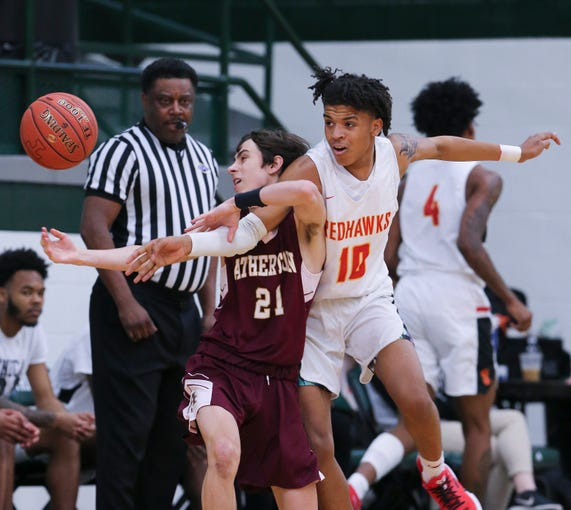 Seneca's Devonte Wilson (10) got tangled up with Atherton's Nicholas Farmer (21) as they chased a loose ball during their 27th District semifinal game at Trinity High School in Louisville, Ky. on Feb. 24, 2020.
