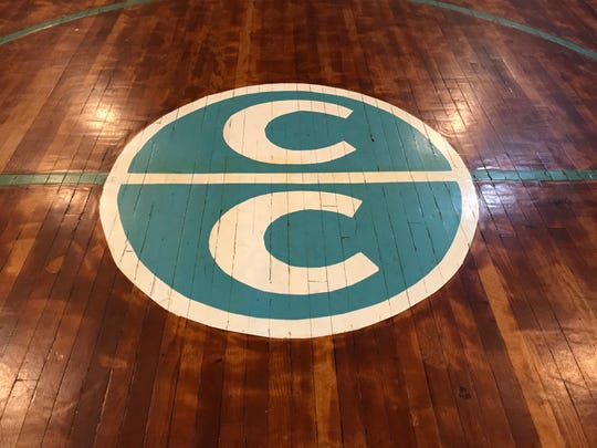 The Carr Creek logo at center court of the high school's gymnasium.