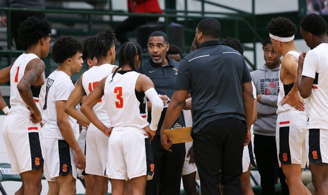 Seneca head coach Miquel Coleman instructs his players against Atherton during their 27th District semifinal game at Trinity High School in Louisville, Ky. on Feb. 24, 2020.