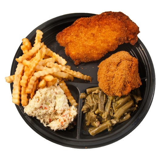 St. Gabriel's men's club fish fry's rolled oyster platter consisting of a fried rolled oyster, a piece of fried codfish, fries, cole slaw and beans. Feb. 24,  2020