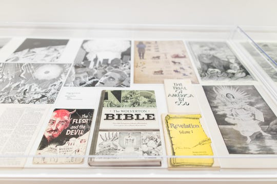 "Objects collected by artist Jim Shaw displayed at Michigan State University's Eli and Edythe Broad Art Museum as part of ""Michigan Stories: Mike Kelley and Jim Shaw,"" an exhibit that ran from November 2017 to February 2018. The museum has since acquired Shaw's collection."