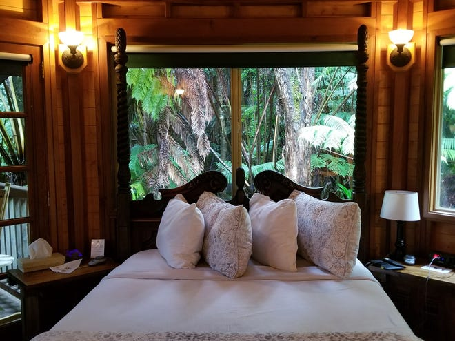 You can stay in a cozy cabin in the rainforest at Volcano Village Lodge on the Big Island.