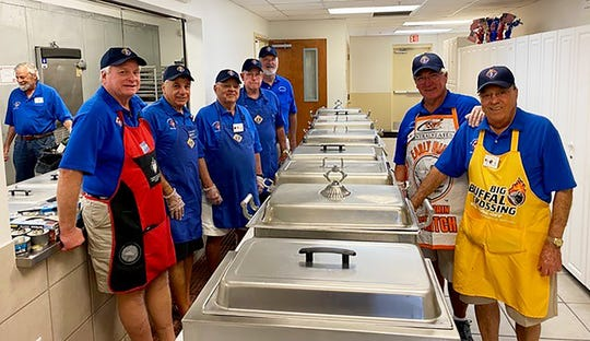 On Feb. 18, the Knights of Columbus San Marco Council #6344 held a Spaghetti Dinner in the San Marco Parish Center to benefit the local charities. Above: The Knights' kitchen crew prepared excellent food and the serving line served a great meal.