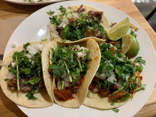 Two carnitas tacos and two tacos al pastor from ZaZa, Marco Island.