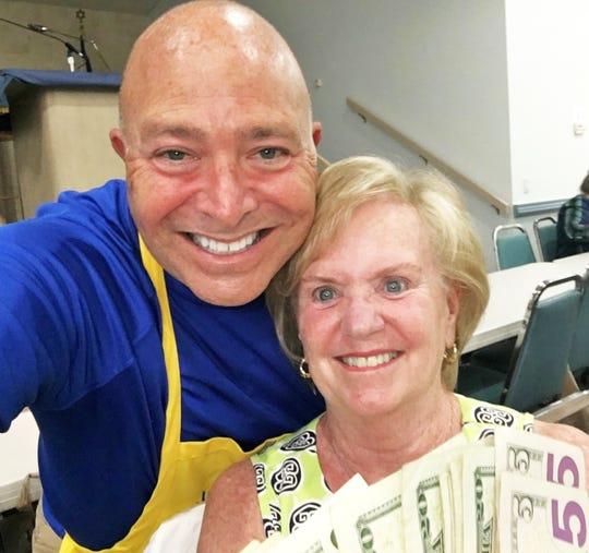 JCMI Bingo's big winner Betty Sadow with Mitch Braun.