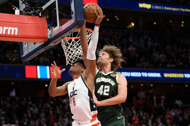Bucks center Robin Lopez stuffs the shot attempt of Wizards forward Rui Hachimura next to the rim near the end of regulation to help send the game into overtime.