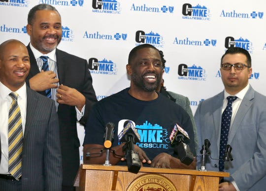 """Gaulien """"Gee"""" Smith, owner of Gee's Clippers, lists the names of family members who died before the age of 65, saying they're the reason opening a clinic in his barber shop means so much to him. Other officials applauded the launch of a free clinic to support men's health in Milwaukee, dubbed the MKE Wellness Clinic, at Gee's Clippers on Tuesday."""