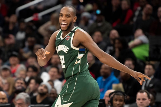Bucks forward Khris Middleton is in a good mood after sinking a a three-pointer during the second half against the Wizards.