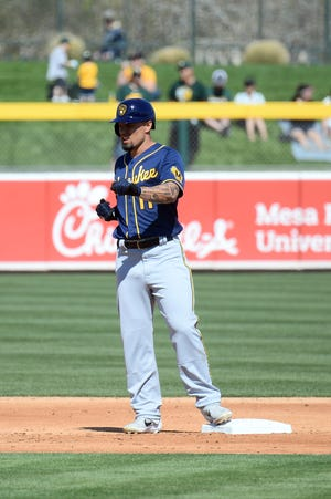 Brewers outfielder Jace Peterson reacts after hitting an RBI double against the Athletics during the second inning.