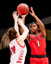 Pike Road's Skye Harris-Butler shoots over Pisgah's Chloe Womack during the AHSAA Finals at Legacy Arena in Birmingham, Ala., on Tuesday February 25, 2020.