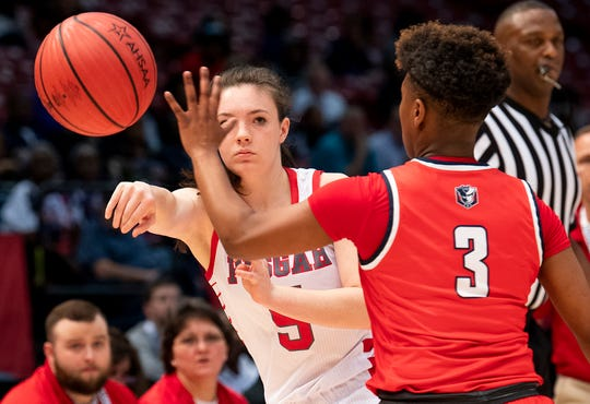 Pisgah's Kennedy Barron passes against Pike Road's Sheria Clement during the AHSAA Finals at Legacy Arena in Birmingham, Ala., on Tuesday February 25, 2020.