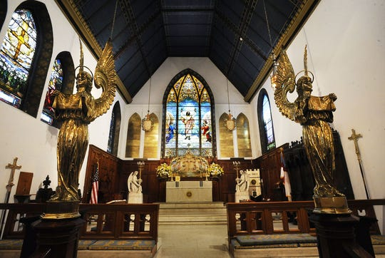 A pair of brass angels along the chancel rail in front of the sanctuary in St. John's Episcopal Church in downtown Montgomery.