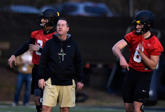 Vanderbilt offensive coordinator Todd Fitch watches quarterbacks Jeremy Moussa, left, and Ken Seals (8) pass during the first day of spring practice Tuesday.