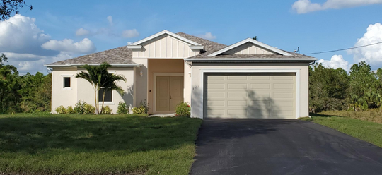 The Violeta by FL Star is a spacious move-in ready home located on acreage in Golden Gate Estates.
