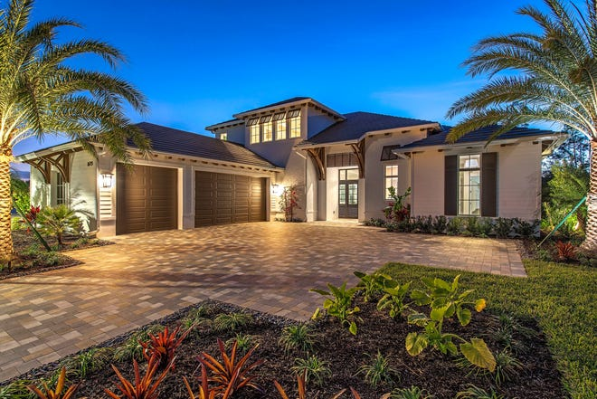 Three-car garages and paver driveways are standard throughout the 18-acre development of The Enclave of Distinction in North Naples.