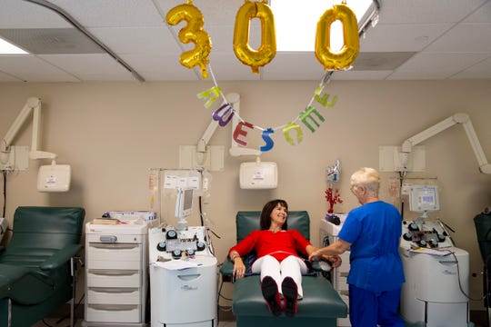 """Diane Meyer donates platelets at the NCH Community Blood Center in Naples on Tuesday, February 25, 2020. Meyer has made 300 donations, but doesn't plan to stop anytime soon, """"as long as I'm healthy and I can, there's no reason not to,"""" she said."""