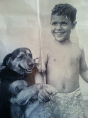 John DeCando has always been an animal lover. He is with his family dog in this undated photo.