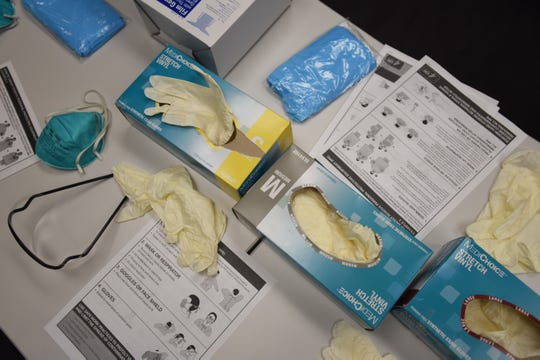 Close up of gloves in boxes, masks, gowns and copies of manuals during the Covid 19 Training with Personal Protective Equipment (PPE) at the hospital's simulation center of Holy Name Medical Center in Teaneck on 02/24/20.