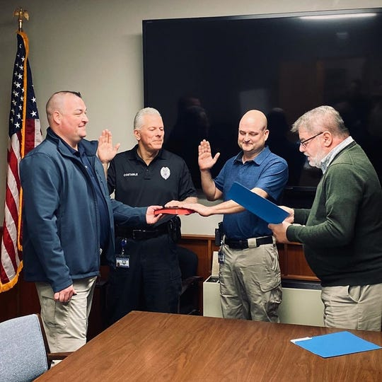 Retired Wayne police corporals John Costabile and Brent Cannon, accompanied by acting Police Chief John McNiff, are sworn in as Class III officers by Mayor Christopher Vergano.