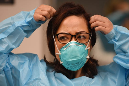 Nurse Jennifer Tempo, RN, puts on a mask during the Covid 19 Training with Personal Protective Equipment (PPE) at the hospital's simulation center at Holy Name Medical Center in Teaneck on 02/24/20.