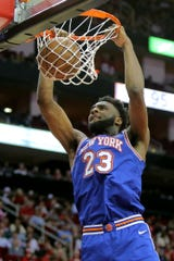 Feb 24, 2020; Houston, Texas, USA; New York Knicks center Mitchell Robinson (23) makes a slam dunk against the Houston Rockets during the fourth quarter at Toyota Center. Mandatory Credit: Erik Williams-USA TODAY Sports