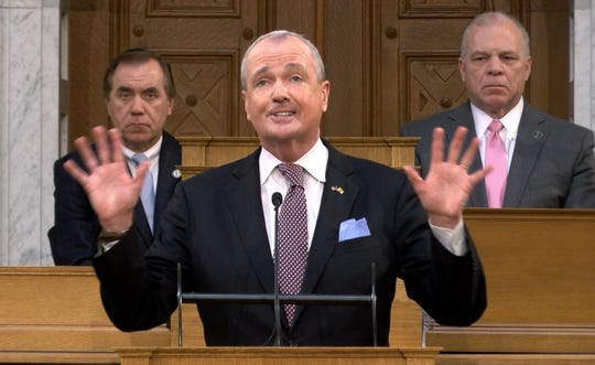 New Jersey Governor Phil Murphy delivers his Budget Address in the Assembly Chamber at the Statehouse in Trenton Tuesday, February 25, 2020.  Behind him are Assembly Speaker Craig Coughlin and Senate President Steve Sweeney.