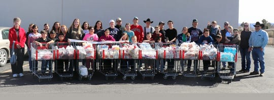 """Luna County 4-H members spent Monday, Feb. 17, shopping for food items at Peppers Supermarket for its annual """"Our Food Link"""" project. Members shop for the Healing House, Luna County's shelter for victims of domestic violence in Deming, NM."""