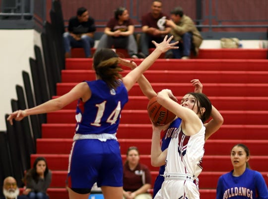 Junior Lady 'Cat Sierra Manos (with ball) played huge in the paint and contributed 12 points and a strong effort off the glass in Deming's 48-38 win over Las Cruces High.