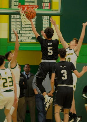 The Oñate boys basketball team hosts Centennial in the District 3-5A tournament semifinals on Wednesday.