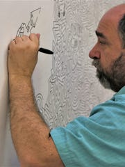 """Maze artist Joe Wos presents two cartooning workshops Feb. 29 at the Farmington Public Library in conjunction with the """"Thinking Money for Kids"""" exhibition."""