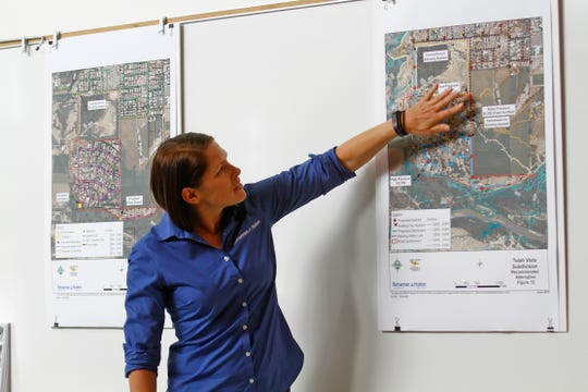 Kirsty Bramlett, an engineer with Bohannan Huston, Inc., talks about plans to address water quality concerns in the Totah subdivision, Thursday, Sept. 22, 2016 at the Sycamore Park Community Center in Farmington.