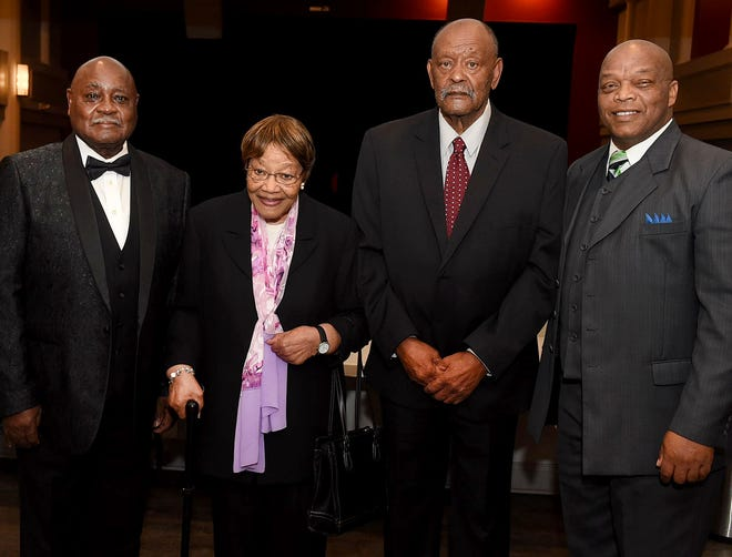 "From left, Rev. Frank Ford, Regina Tatum and Clarence ""Butch"" Fontenot honored Sunday as outstanding citizens during a ceremony including St. Landry Parish Councilman Jerry Red at the Delta Grand Theatre."