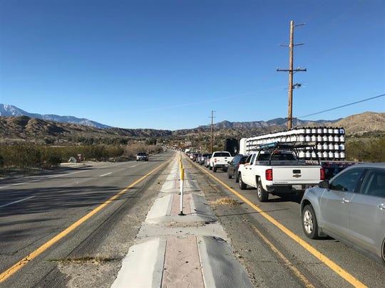 A traffic crash, as well as scheduled road maintenance, has traffic at a standstill along Highway 62 Tuesday, Feb. 25, 2020.