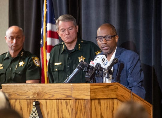 Escambia County Commissioner Lumon May talks during a press conference Tuesday about a recent increase in gun violence.