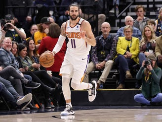 Phoenix Suns guard Ricky Rubio (11) calls a play against the Utah Jazz during the second quarter at Vivint Smart Home Arena.