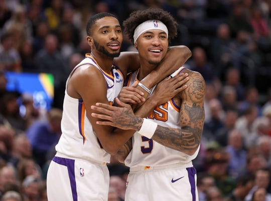Feb 24, 2020; Salt Lake City, Utah, USA; Phoenix Suns forward Mikal Bridges (25) and forward Kelly Oubre Jr. (3) react to a foul called on Oubre during the second quarter against the Utah Jazz at Vivint Smart Home Arena. Mandatory Credit: Chris Nicoll-USA TODAY Sports